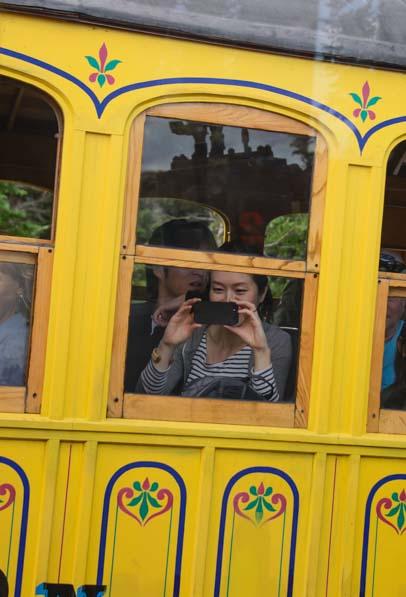 Passenger takes a photo of passing Cog Railway Train Mt Washington New Hampshire