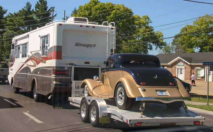 Motorhome towing an antique car