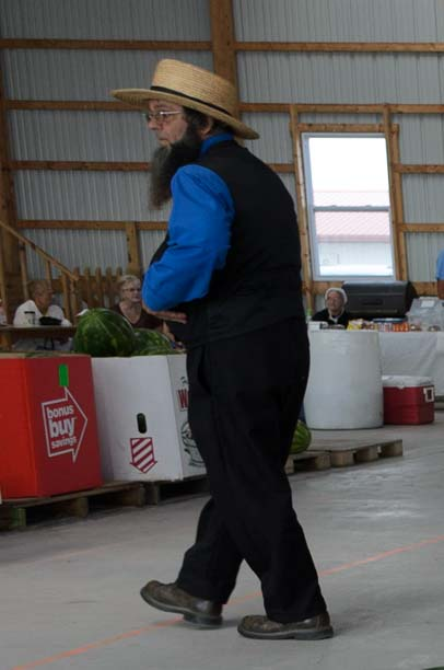 Amish man at farm auction Finger Lakes New York