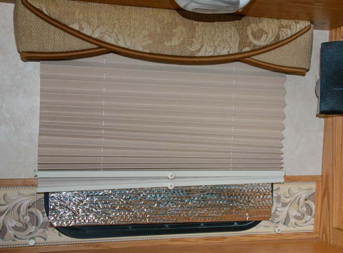 Reflectix insulation keeps heat from escaping out an RV window