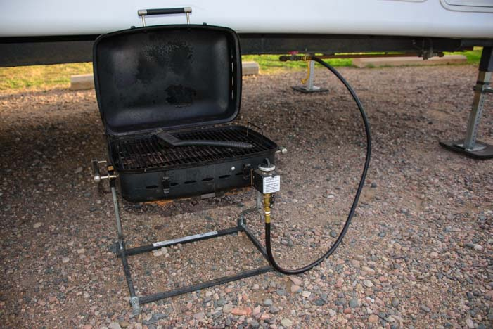 RV grill attached to fifth wheel trailer