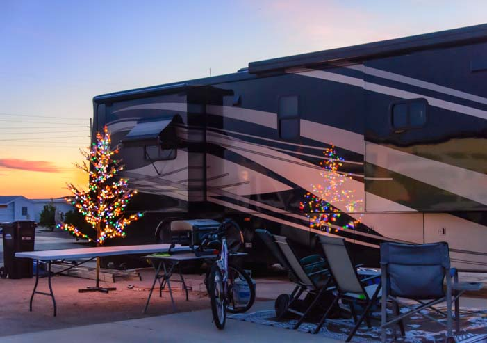 Christmas tree reflected on side of motorhome