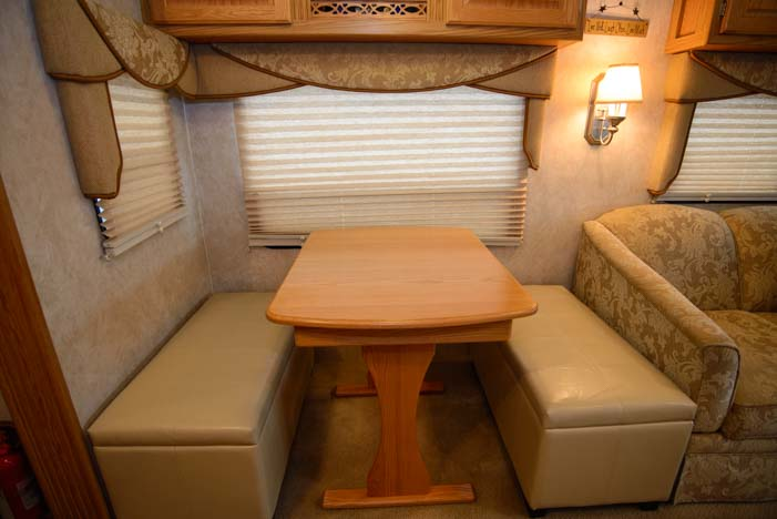 RV dinette with storage benches instead of chairs