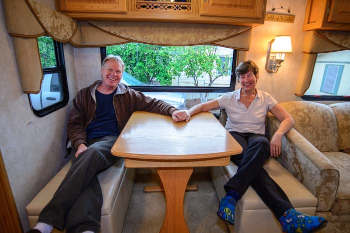 Sitting on storage ottoman benches in RV dinette.jpg