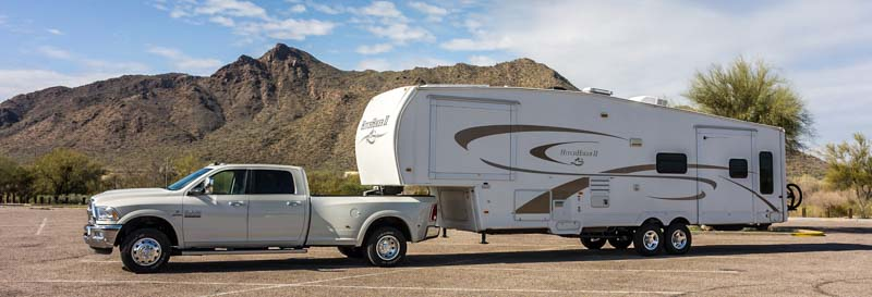 5th wheel trailer and Ram 3500 dually truck hitched up towing