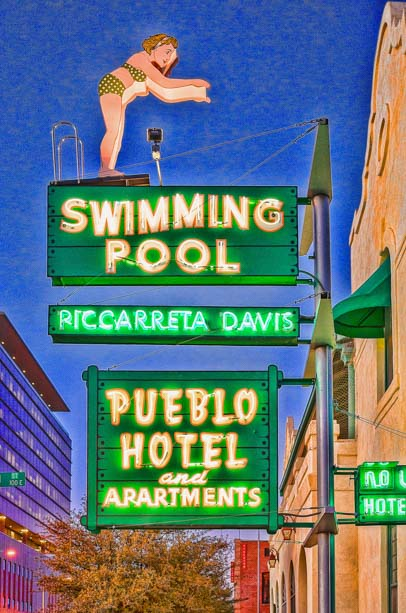 Pueblo hotel and swimming pool sign