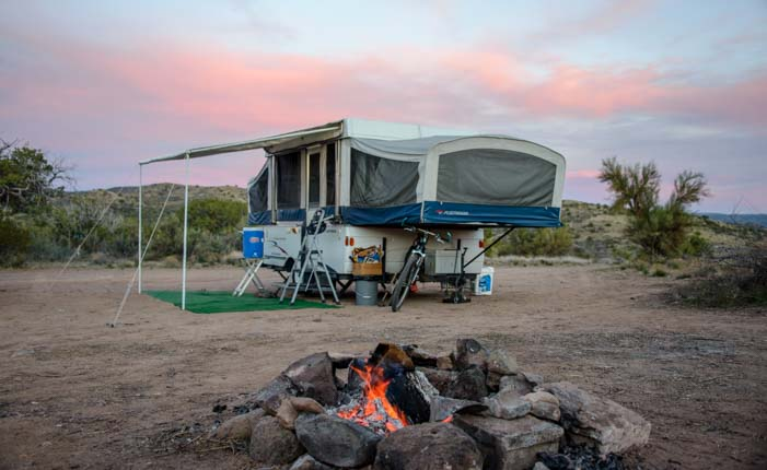Popup tent trailer RV and campfire