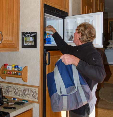Defrost RV refrigerator remove food from freezer