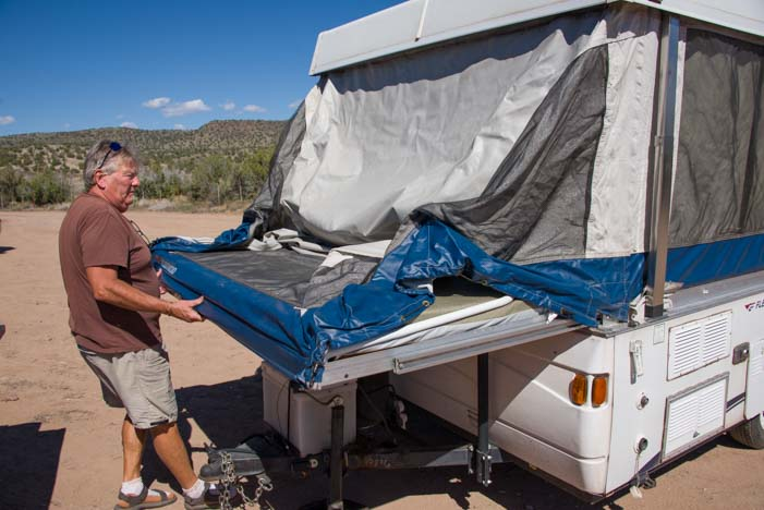 Sliding out a bed slide in popup camper trailer RV