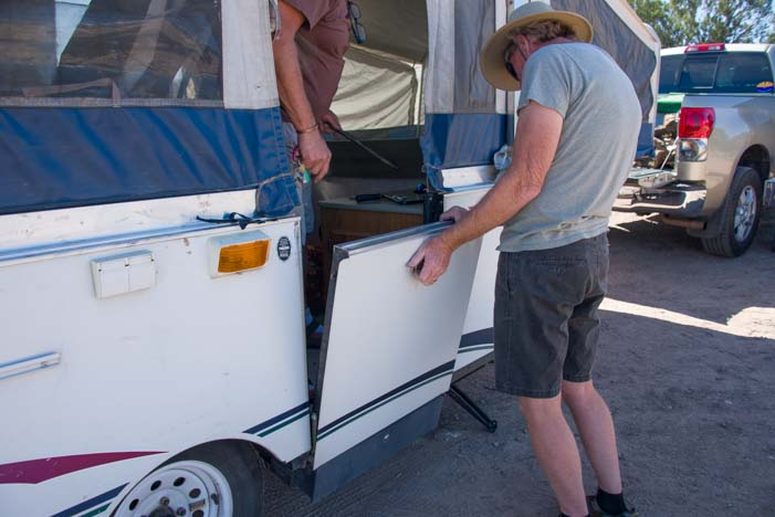 Setting up the door in a folding tent trailer RV