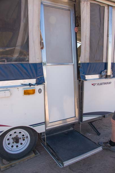Door in place folding tent trailer RV