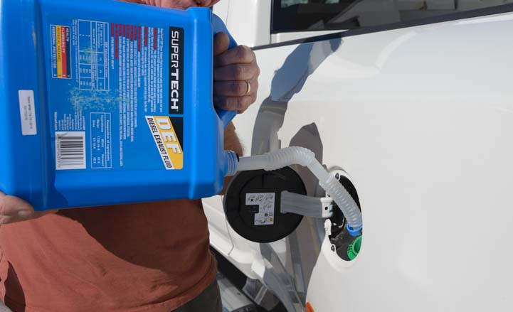 Pouring DEF fluid Diesel Exhaust Fluid into the truck