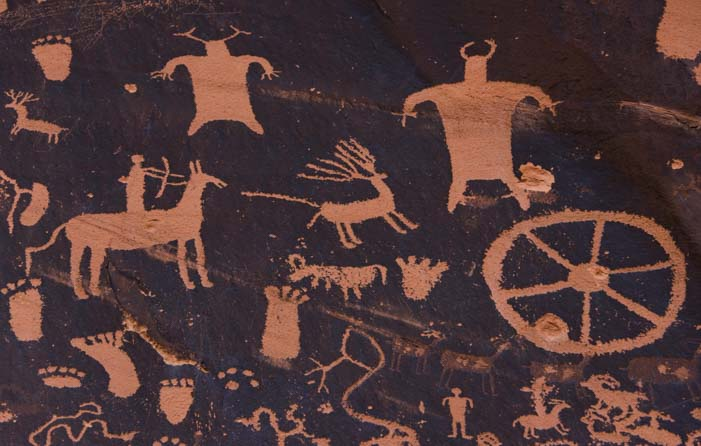 Petroglyphs Newspaper Rock Utah Elk hunt and people with horns