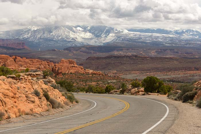 Snowcapped mountains and red rocks Moab Utah