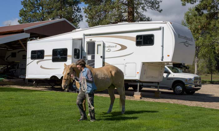 Fifth wheel trailer RV and a horse