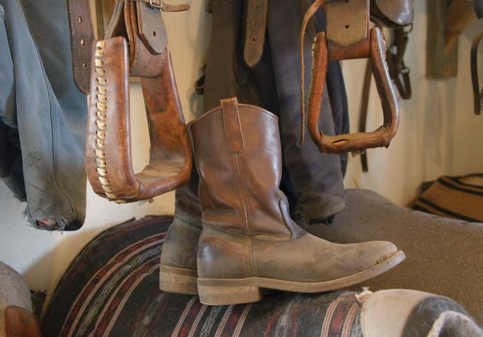 Horse saddles and cowboy boots_