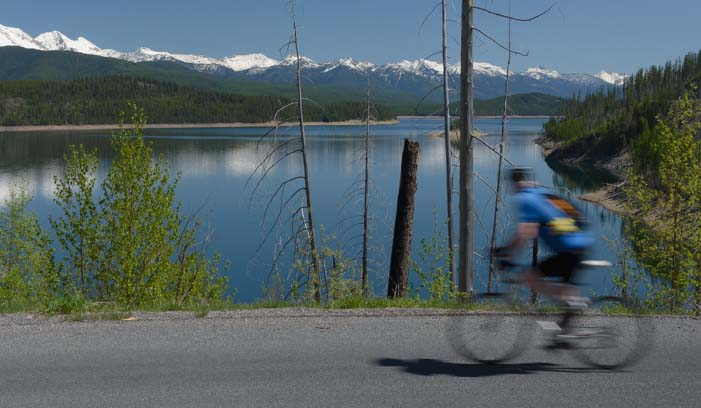 Cyclist checks out the view at Hungry Horse Reservoir Montana