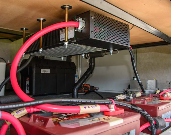 Exeltech 2000 watt pure sine wave inverter installed above Trojan Reliant AGM batteries in fifth wheel RV