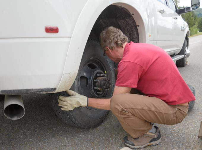 Remove the inner rear tire of a dually truck