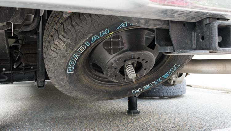 Lowering the spare tire on a Ram 3500 pickup truck