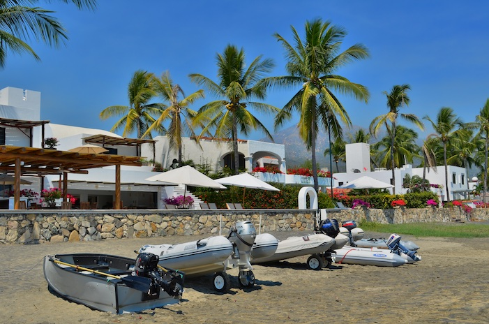 Dinghies lined up on the beach Santiago Bay Manzanillo Mexico Costalegre