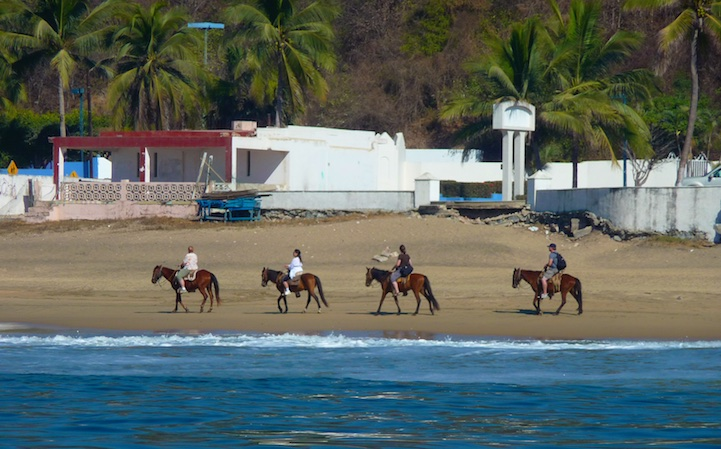 Horseback riding on Santiago Bay Manzanillo Mexico Pacific Coast