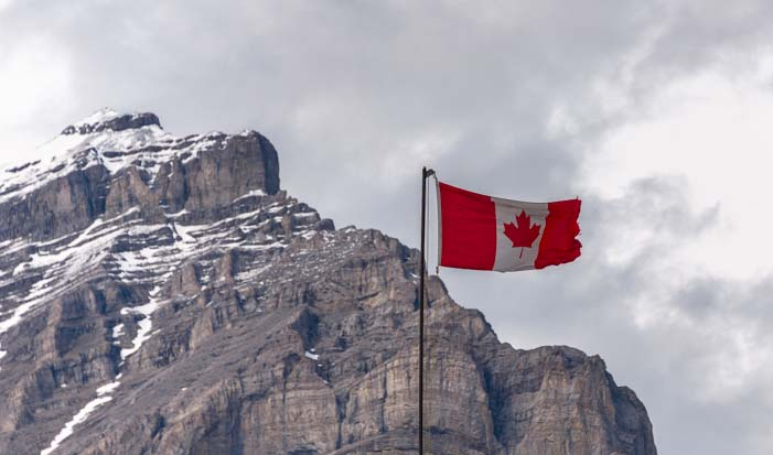 Canadian Rocky Mountains and Canadian Flag
