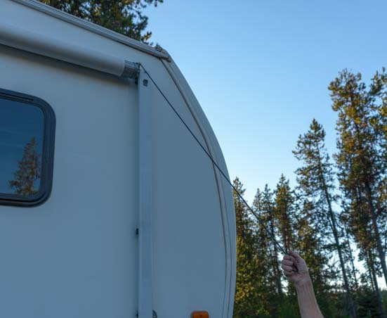 How to set up RV awning - use tool to lower lever