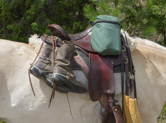 Boots and packs on a long ride on a horse
