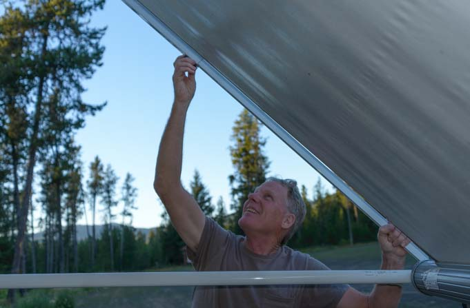 How to set up RV awning - Tighten down other awning arm