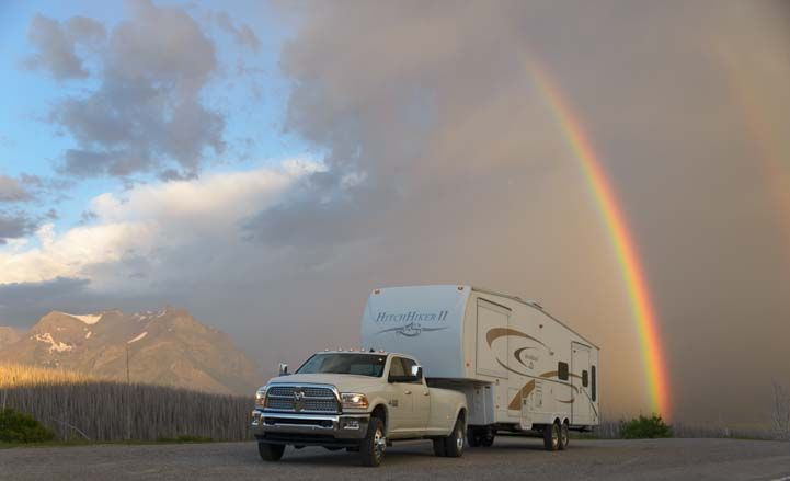 RV under rainbow Glacier National Park Montana