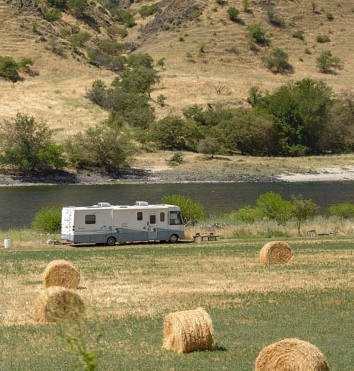 Motorhome among hay bales in Idaho