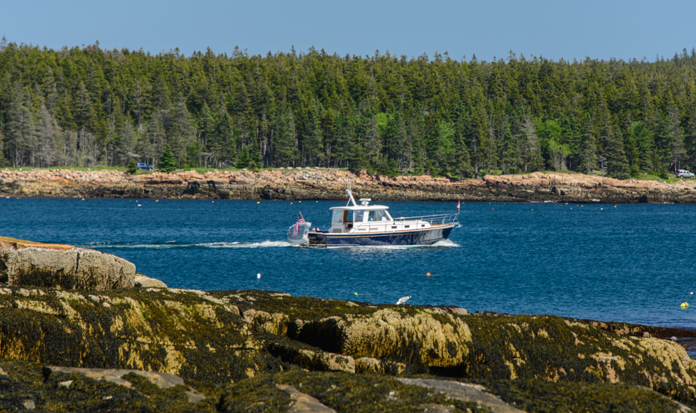 A boat leaves the harbor in Maine's Acadia National Park