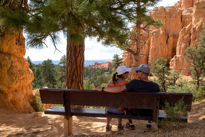 Couple on park bench in Red Canyon Utah