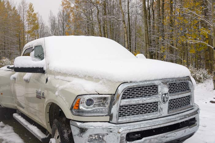 Dodge pickup truck covered in winter snow