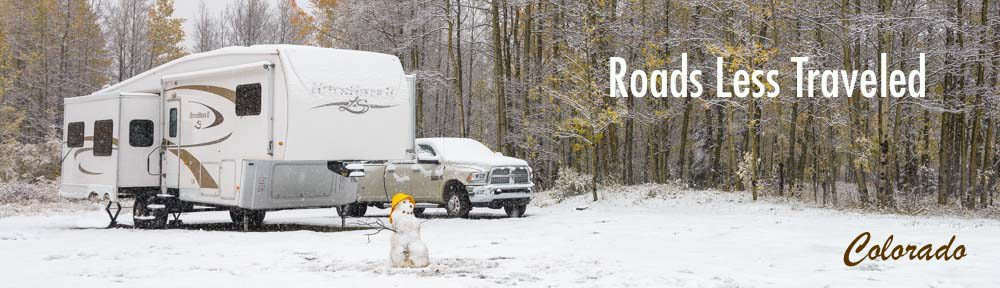 Colorado RV winter camping with snowman