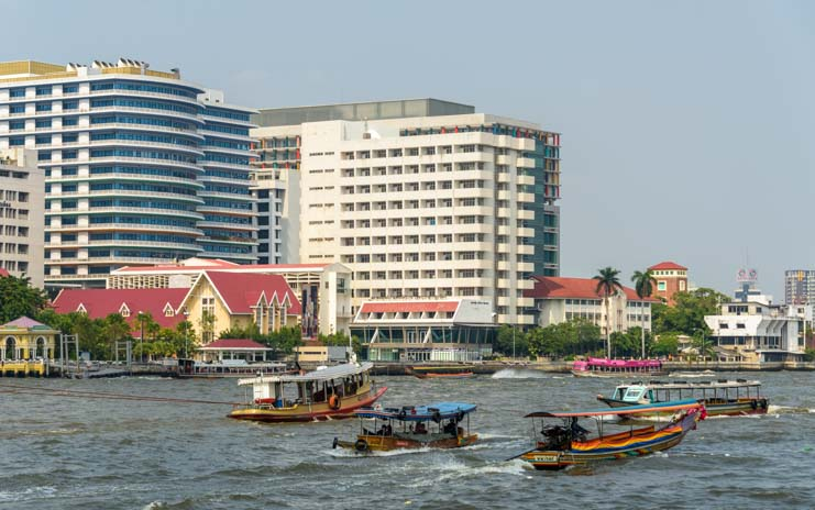 Boats seen from the Chao Phraya Tourist Boat Bangkok Thailand