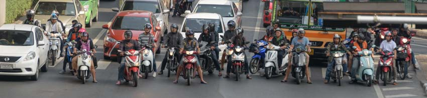 Motorbikes line up at intersection in Bangkok Thailand