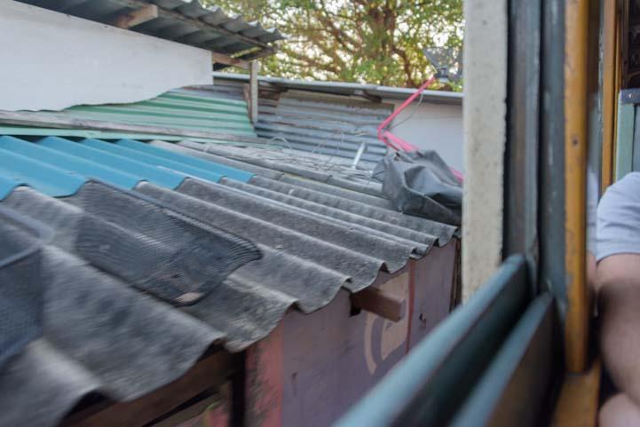 Houses by window Train from Bangkok to Kanchanaburi Thailand