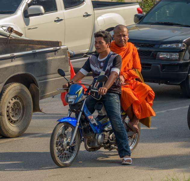 Buddhist monk on motorbike Thailand