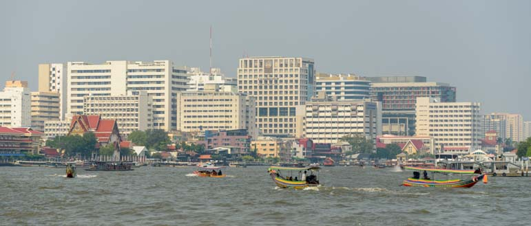 Boats and buildings Chao Phraya River Bangkok Thailand
