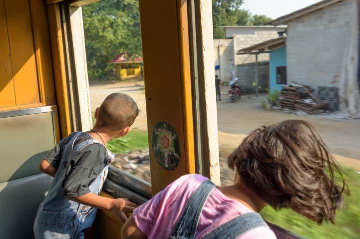 Kids on Train from Bangkok to Kanchanaburi Thailand