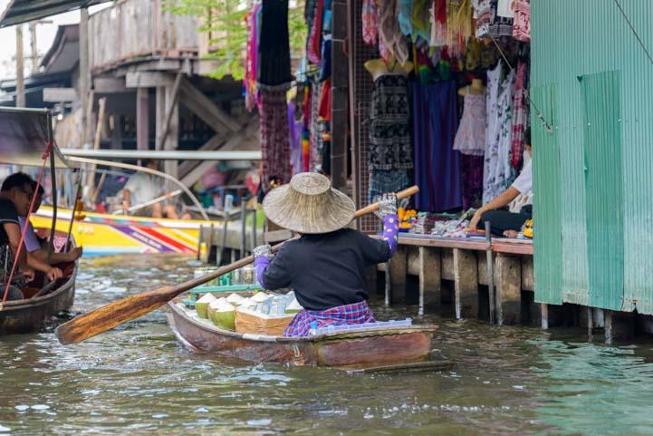 Woman vendor damnoen saduak floating market Bangkok Thailand