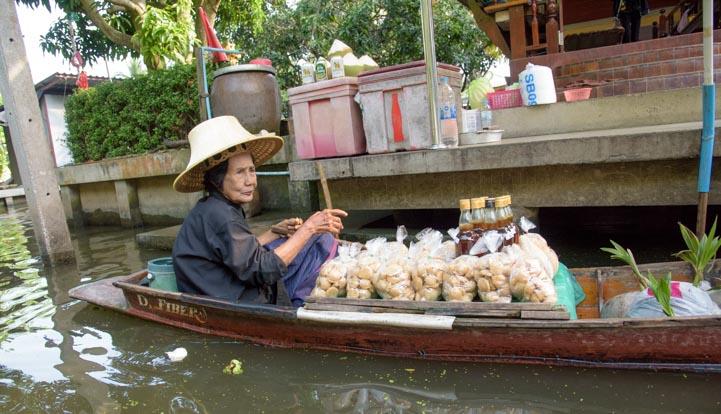 Boat selling produce Damnoen Saduak Floating Market Bangkok Thailand
