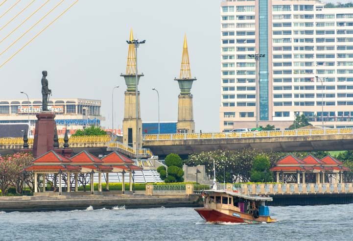 Tourist Boat and suspension bridge Chao Phraya River Bangkok Thailand