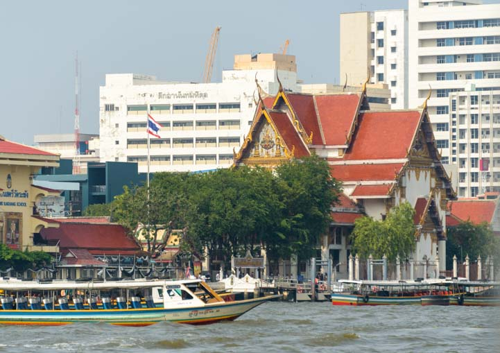 Temple and boat Chao Phraya River Bangkok Thailand