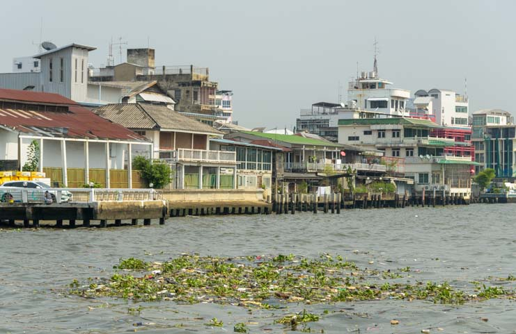 Debris and Houses on Chao Phraya River Bangkok Thailand