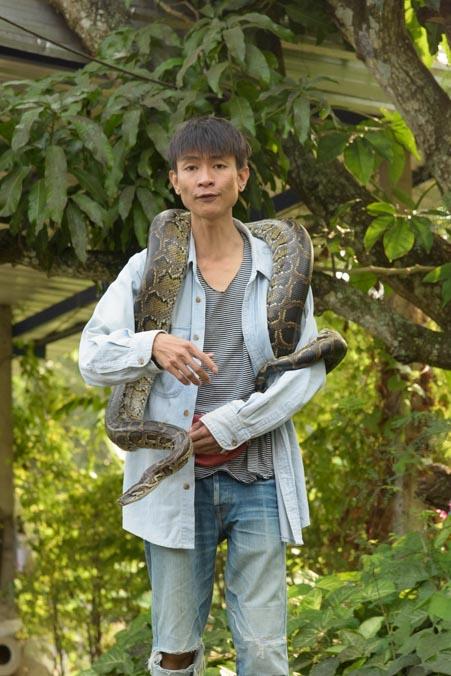 Snake charmer Damnoen Saduak Floating Market Bangkok Thailand