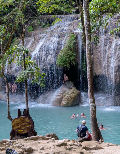 Swimming at Erawan Waterfall Erawan National Park Kanchanaburi Thailand
