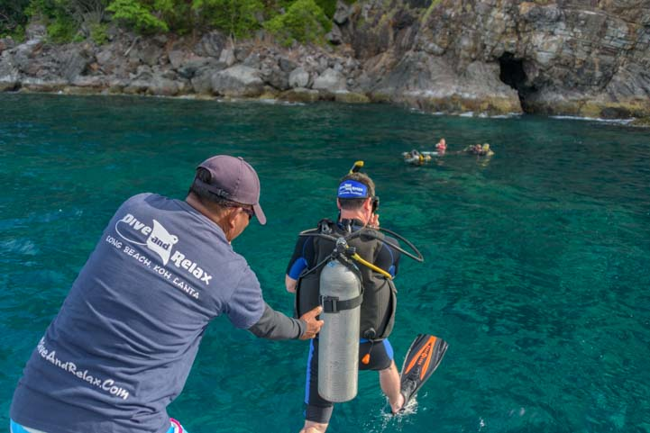 Diver jumps off boat Dive & Relax Ko Rok Snorkeling Tour Ko Lanta Thailand
